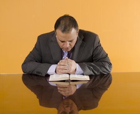 Catholic business man praying in his break Stock Photo - 13296894