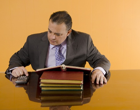 Bookkeeper in his office doing math Stock Photo - 13296913
