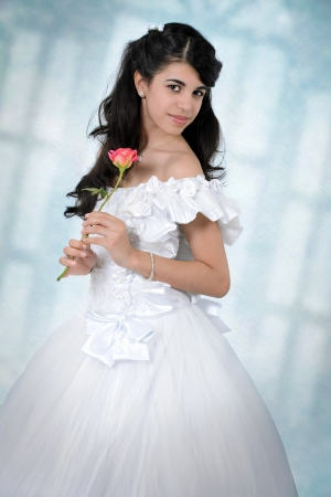 15 year old: Pretty Hispanic teenagers wearing a white dress Stock Photo