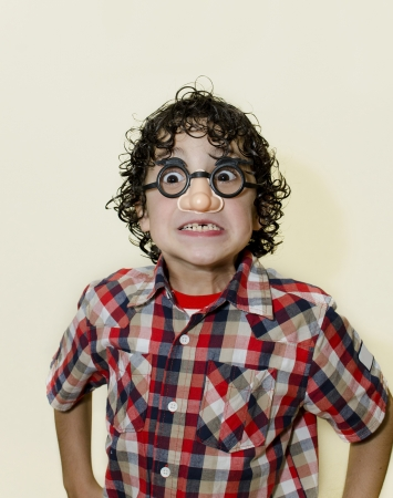 Hispanic boy playing around and making funny faces photo