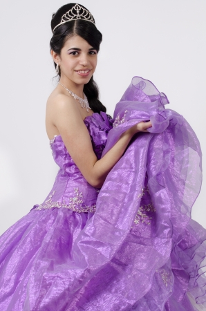 Young teenager wearing a purple dress Stock Photo