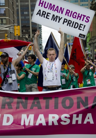 bisexual: Toronto, Canada - July 1, 2012: Goran Miletic -International Grand Marshal of the  Pride Parade- partaking in  the closing activity of the Torontos  Pride Festival which celebrates the history, courage, diversity and future of the Lesbian, Gay, Bisexual, Editorial