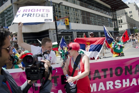 bisexual: Toronto, Canada - July 1, 2012: Goran Miletic -International Grand Marshal of the  Pride Parade- interviewed while partaking in the parade which celebrates the history, courage, diversity and future of the Lesbian, Gay, Bisexual, Transsexual, Transgender, Editorial