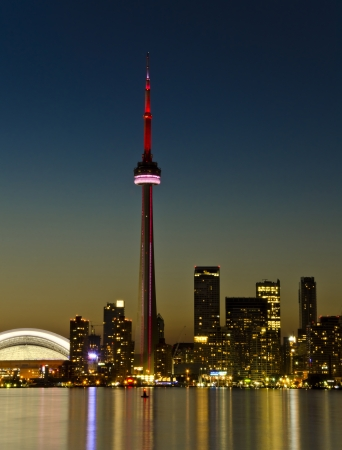 toronto: Toronto, Canada - July 2, 2012: CN Tower at Night. One of the highest structures in the world and a tourist landmark Editorial