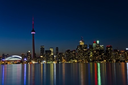 View of Toronto skyline in the dusk hour, beautiful light colours reflected on the lake water photo