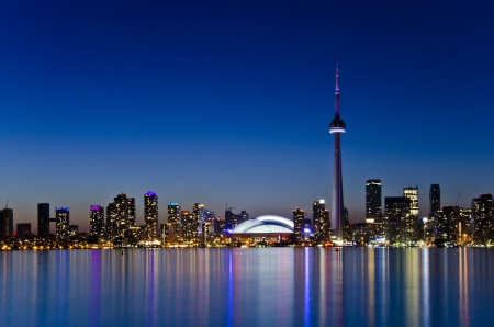 View of Toronto skyline in the dusk hour, beautiful light colours reflected on the lake water Stock Photo - 14316624