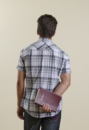 Hispanic Teeenager holding a Holy Bible photo