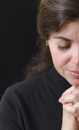 Hispanic woman praying and praising the Lord photo