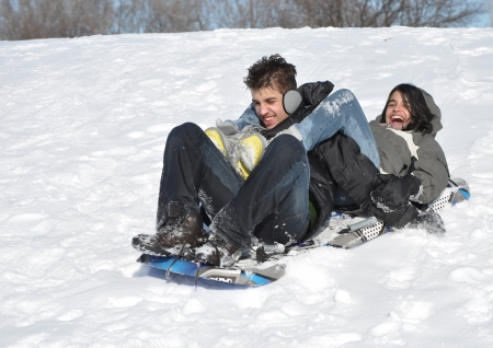 Couple of teens celebrating life in winter time photo