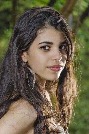 Portrait of a beautiful Latin teenager taken outdoors 写真素材