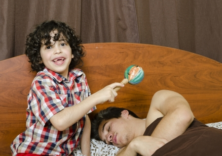 Young boy awakes his brother by making noises Stock Photo - 16409366