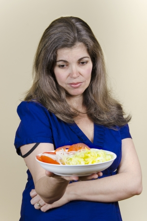Latin woman who will enjoy eating a vegetable salad Stock Photo - 16634846
