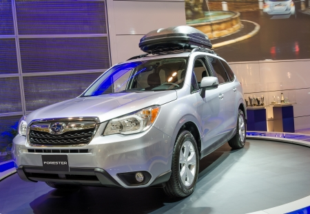 forester: TORONTO-FEBRUARY 15: Exhibition of the  2014 Subaru Forester  during  the Torontos International Auto Show 2013. The show is arriving to 40 years this 2013. Editorial
