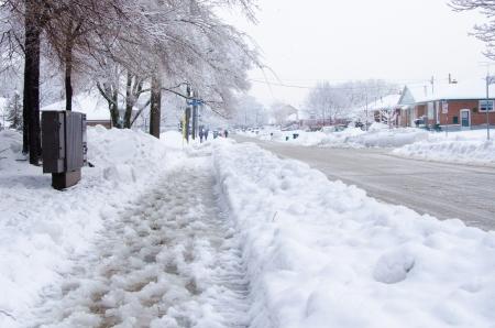 slushy: Slush and snow in the sidewalk in a cold winter day