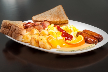 Wonderful dish of scrambled eggs and sausage photo