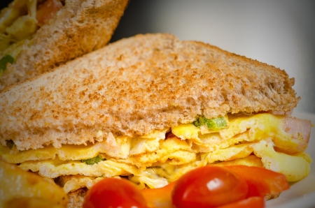 Omelette sandwich with green peppers and side of potatoes