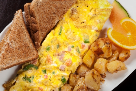 Upper view of a tasty omelette served for breakfast in a restaurant photo