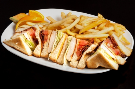 Assorted small sandwiches of pork steak and bacon with french fries photo