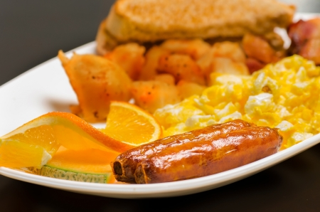 Delicious breakfast prepared with scrambled eggs and sausage