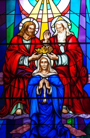 Colorful and beautiful stained glass in a Catholic Church. Different religious meanings and scenes of the Christians traditions photo