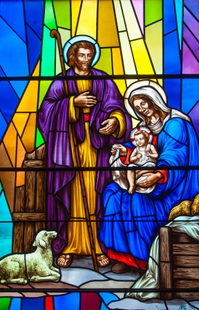 stained glass windows: Colorful and beautiful stained glass in a Catholic Church. Different religious meanings and scenes of the Christians traditions