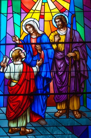 depicted: Colorful and beautiful stained glass in a Catholic Church. Different religious meanings and scenes of the Christians traditions