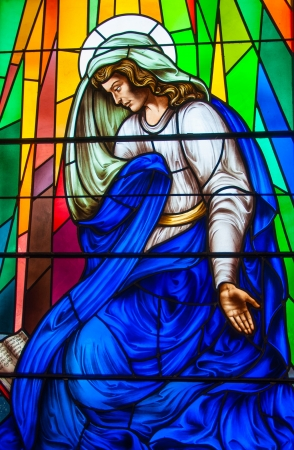 Religious images in a beautiful stained glass in a Catholic churc. Religious depiction of biblical passages photo