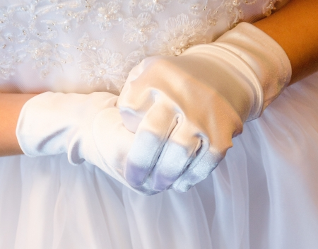 Hands of a girl during her First Communio Ceremony in a Chatholic Church