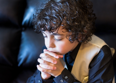 Hispanic child praying and praising God photo