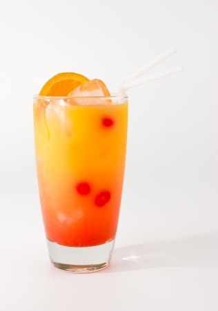 Colorful and cold punch coctail in a long glass photo