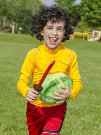 children  play: Hispanic Child Playing Outdoors Stock Photo