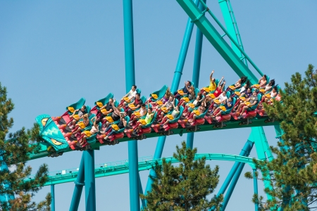 roller coaster: TORONTO - AUGUST 17  The Leviathan one of the biggest and tallest roller coasters in the world  This roller coaster dominates Wonderland