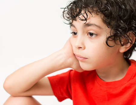 dismayed: Hispanic Child Expressions of sadness, wondering and dispair  Boy with curly hair making different mood expressions  White background picture of a kid making face expressions