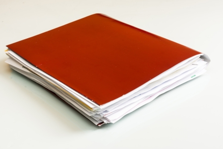 Folder full of business papers  bills, accounts receivable,invoices,receipts,etc  Blue folder with a business paperwork and red tape  Stock Photo - 22118096