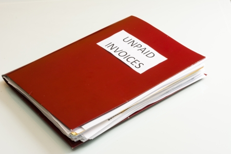 Folder full of business papers  bills, accounts receivable,invoices,receipts,etc  Blue folder with a business paperwork and red tape Stock Photo - 22118117