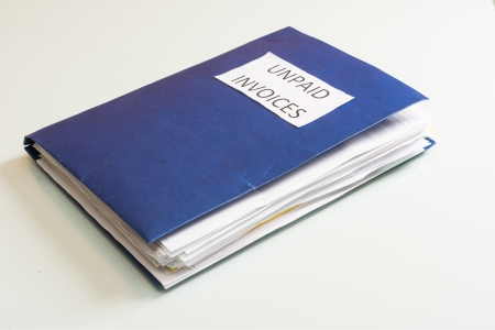 Folder full of business papers  bills, accounts receivable,invoices,receipts,etc  Blue folder with a business paperwork and red tape  Stock Photo - 22118193