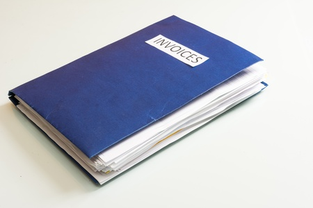 Folder full of business papers  bills, accounts receivable,invoices,receipts,etc  Blue folder with a business paperwork and red tape  Stock Photo - 22118208