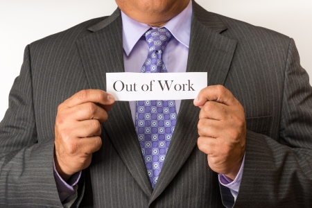 implemented: Business man holding a sign of stressed out  Worsening scenario for white collar workers as technology and flatter structures are implemented in the new business concepts