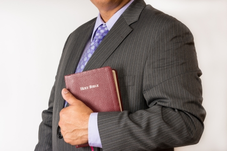 account executive: Business man holding a Bible in the place of work  Man who acts in the business world according to godly principles