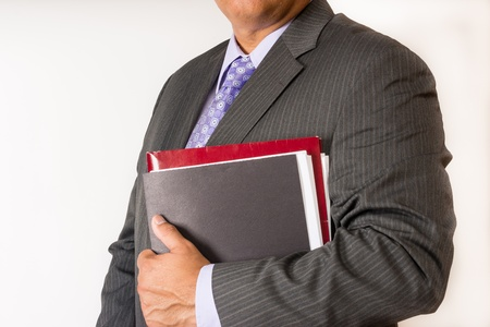 account executive: Torso of a business man holding some files  Man wearing a suit ready for a meeting and holding document files Businessman ready for defending his position in a business meeting