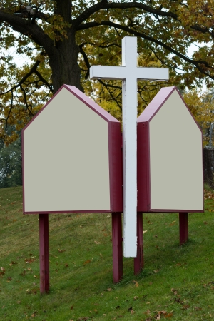 crist: Sign in the entrace of a protestan Christian church. The cross of Crist with enough copy space for writing text Stock Photo