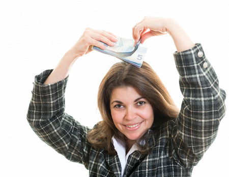 business for the middle: Just money in my head. Constantly thinking about money concept. Hispanic woman with money over her head. Canadian dollars over white background and a successful business woman or entrepreneur.