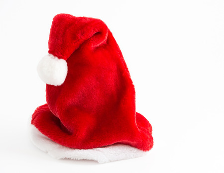 and tradition: Beautiful single red and white Santa Claus hat by itself. Important symbol of the Christmas tradition
