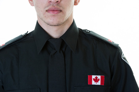 Front view of a police student torso. Details of his uniform and responsible personality