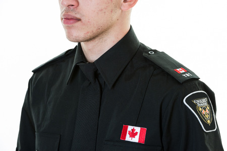 Torso of a Canadian police studen wearing uniform. Hispanic immigrant studying for becoming a policeperson.