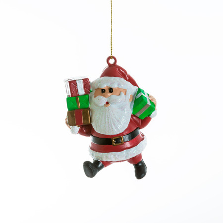 and tradition: Santa Claus with presents. Small Christmas decoration. Cute representation of the Santa Claus tradition