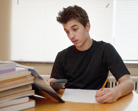 Teenager hard work on studying at home   photo