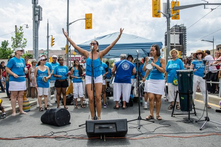 socca: TORONTO,CANADA-AUGUST 7, 2012; Rick Shadrach Lazar and his Samba Squad performs at Salsa on Saint Clair Festival  The group usually partake in this Hispanic Festival