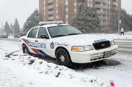 light duty: TORONTO - NOVEMBER 6  Toronto Police Service is the largest municipal police service in Canada and third largest police force in Canada  Serving in the winter Editorial