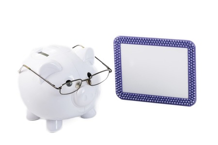 Piggy bank wearing glasses wants to teach people how to save money  photo